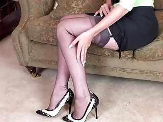 Dark-haired Vicki Peach Strips Off Retro Black Undergarments And Wanks In Stilettos And Nylons