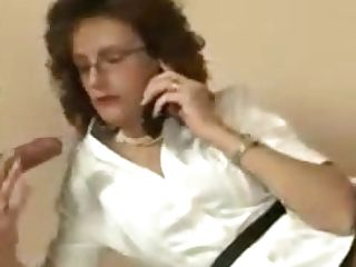 Brit Mummy Plays With A Salami While On The Phone